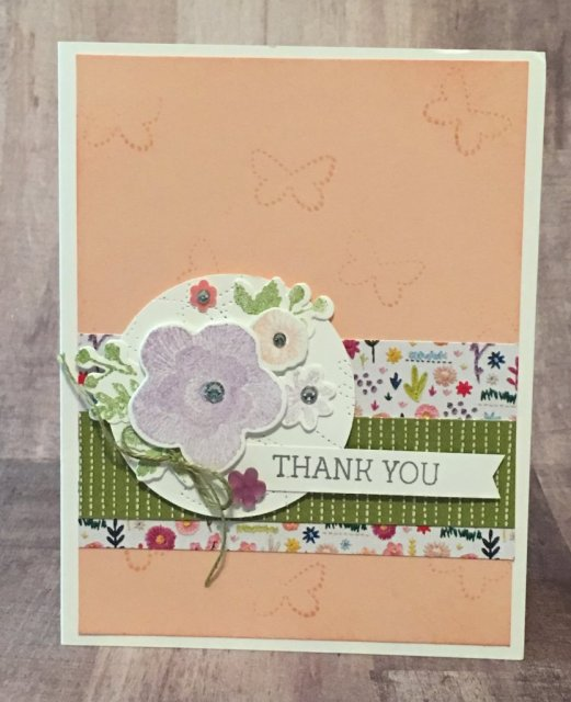 The needlepoint Nook Suite includes-Dainty prints, hand-stitched images, and coordinating embellishments.
